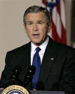 President George W. bush speaking at the podium.