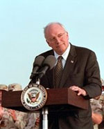 Vice President Dick Cheney speaking at the podium before the troops in Qatar on March 17, 2005.